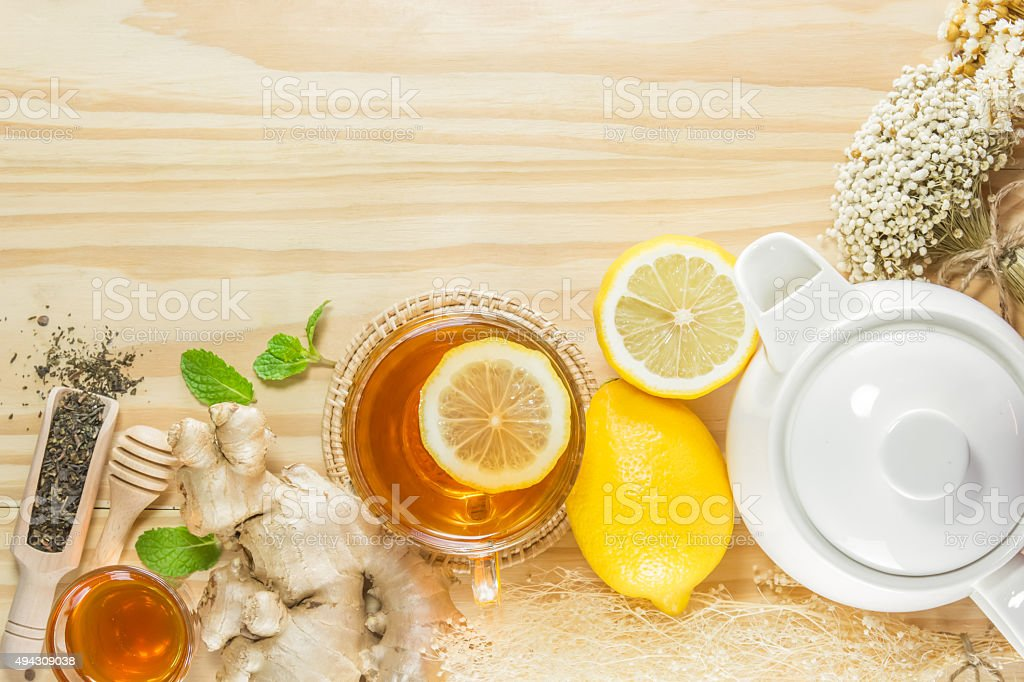 tea with mint honey ginger and lemon on wood background stock photo