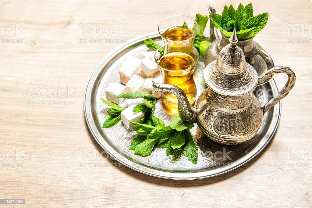 Tea with mint leaves and traditional turkish delight. stock photo