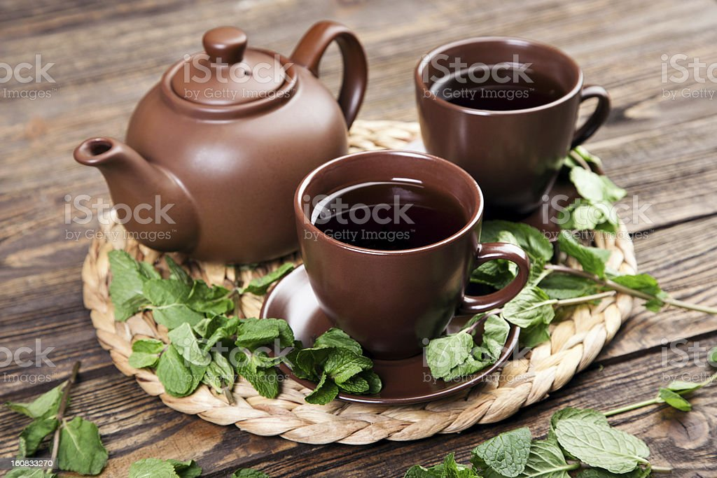 Tea with mint on a wooden table royalty-free stock photo