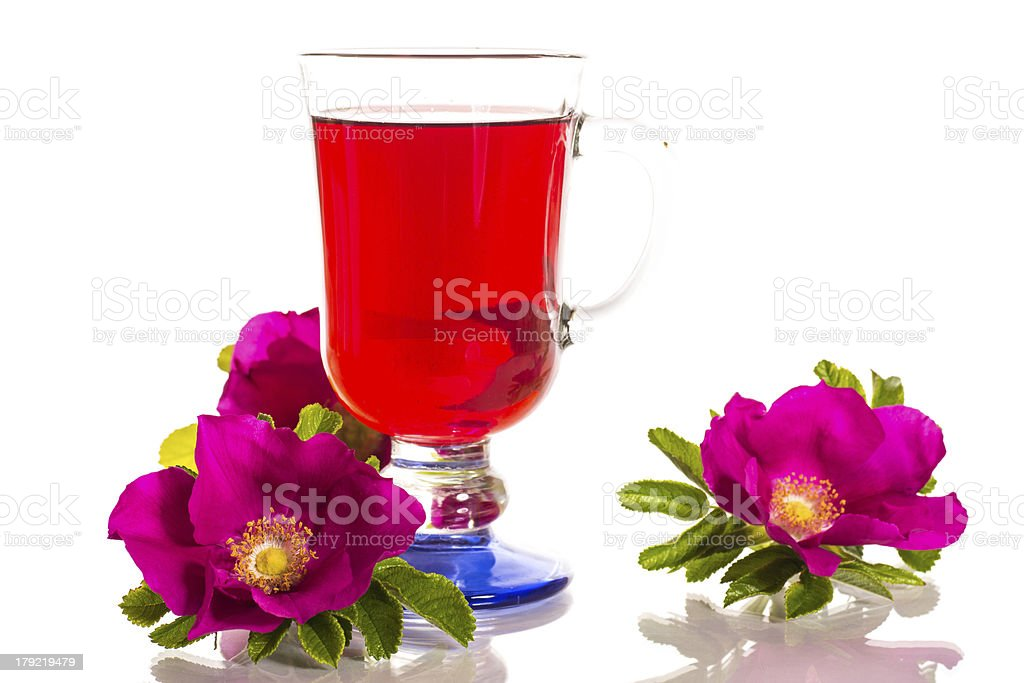 tea with rose hips and flowers royalty-free stock photo