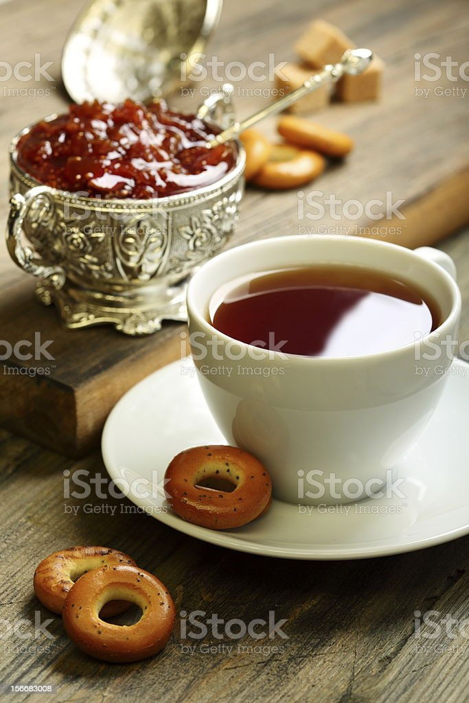Tea with small bagels and fig jam. royalty-free stock photo