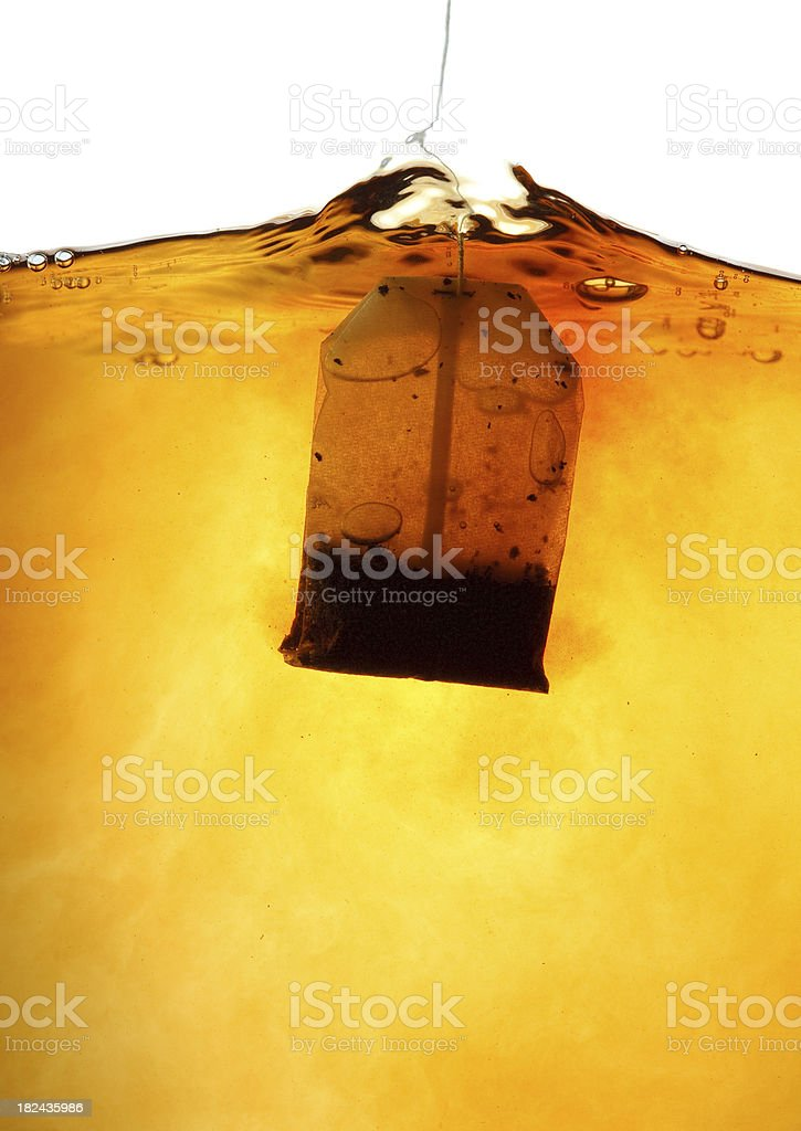 Teabag in hot water royalty-free stock photo