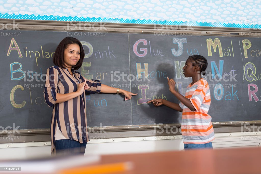A teacher and a student in a sign language class stock photo