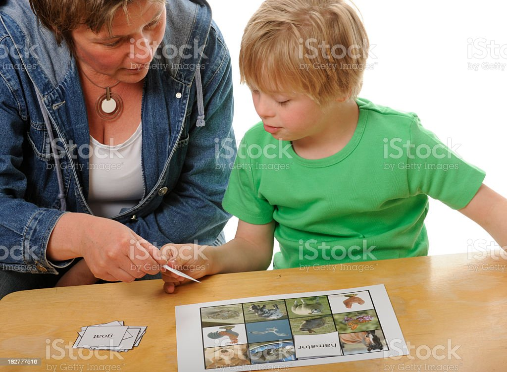 Teacher and boy reading game stock photo