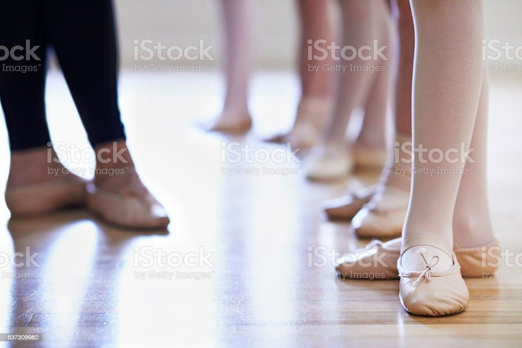 Teacher And Children's Feet In Ballet Dancing Class stock photo