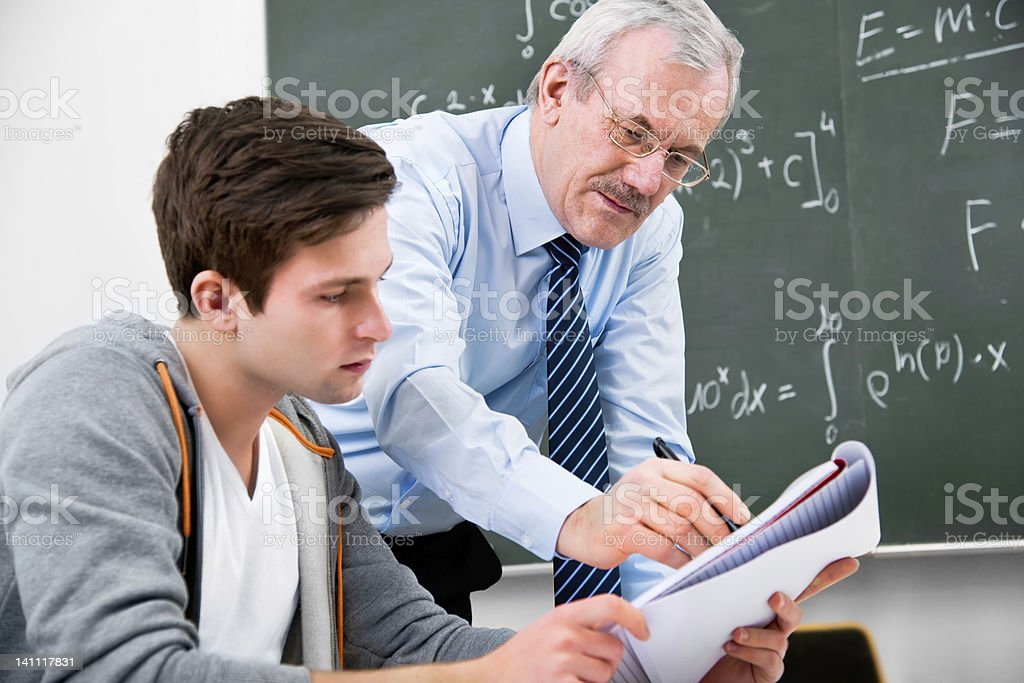 teacher and high school student royalty-free stock photo