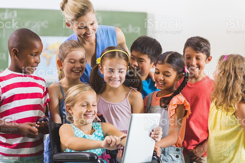Teacher and kids using digital tablet stock photo