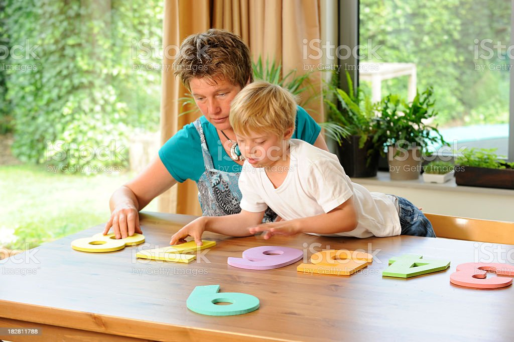 Teacher and pupil playing with digit sequence royalty-free stock photo