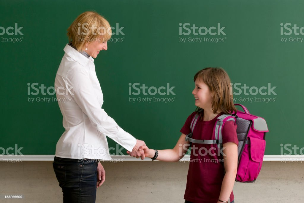 teacher and pupil shaking hands royalty-free stock photo