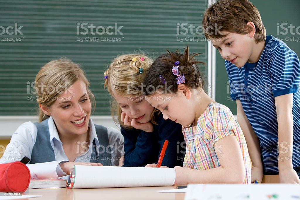 Teacher and pupils royalty-free stock photo