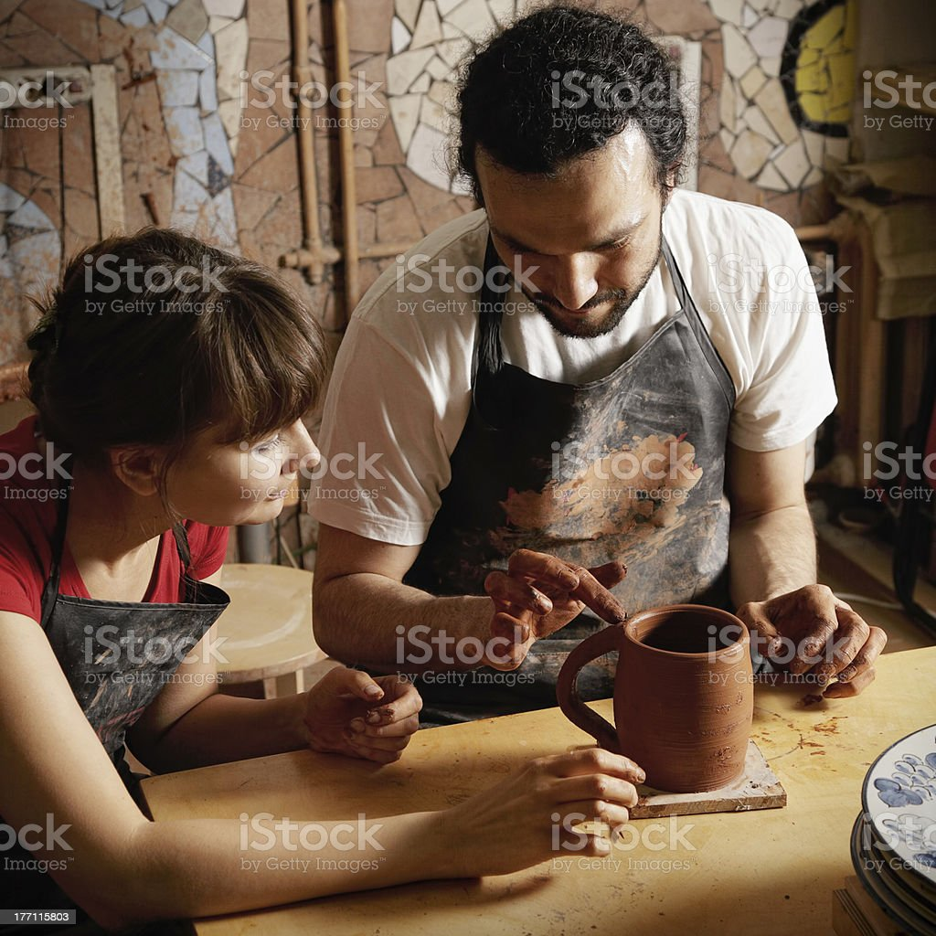 Teacher and student potters stock photo