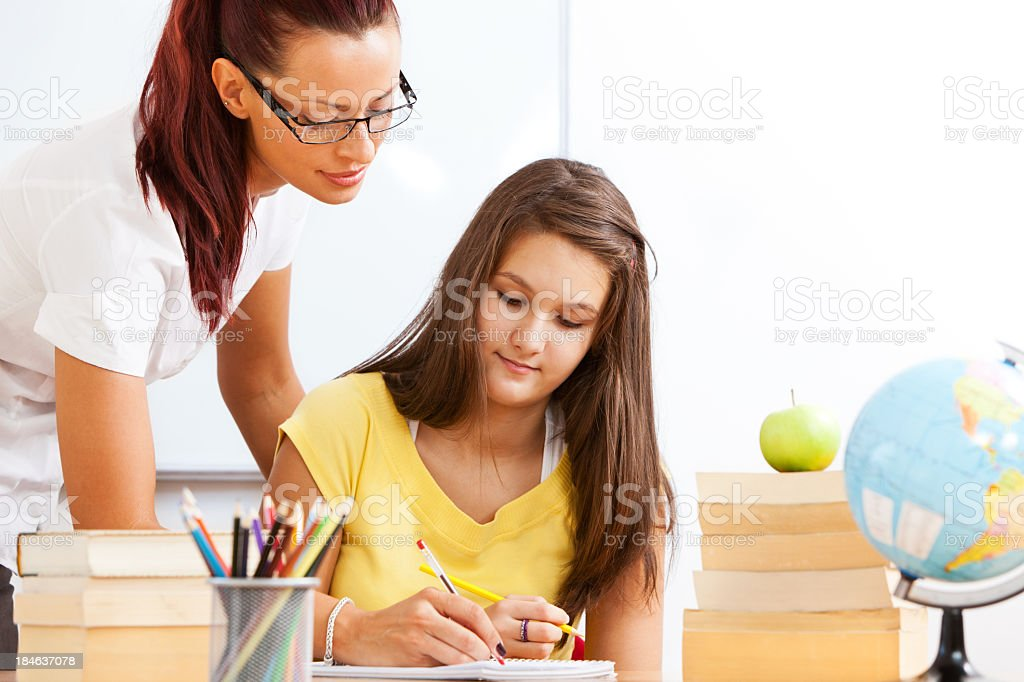 Teacher And Student Working Together royalty-free stock photo