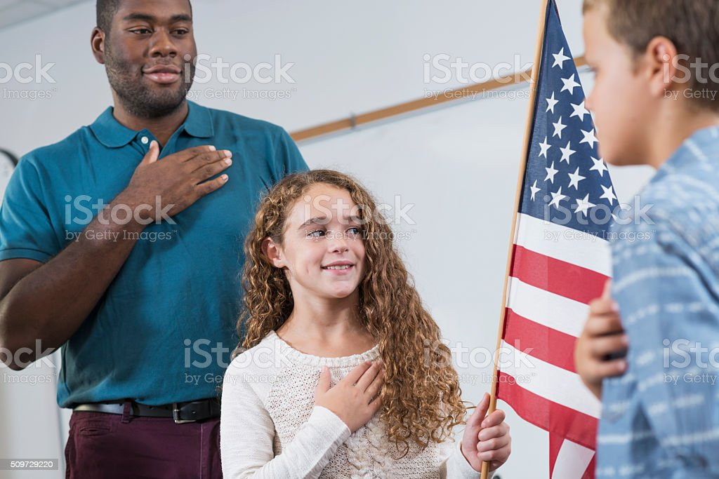 Teacher and students, American pledge of allegiance stock photo