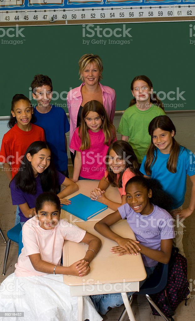 Teacher and Students in a Classroom royalty-free stock photo