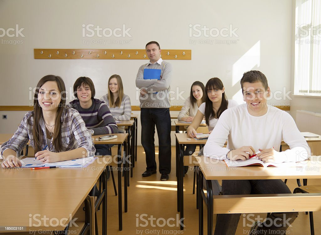 Teacher and students in classroom. royalty-free stock photo