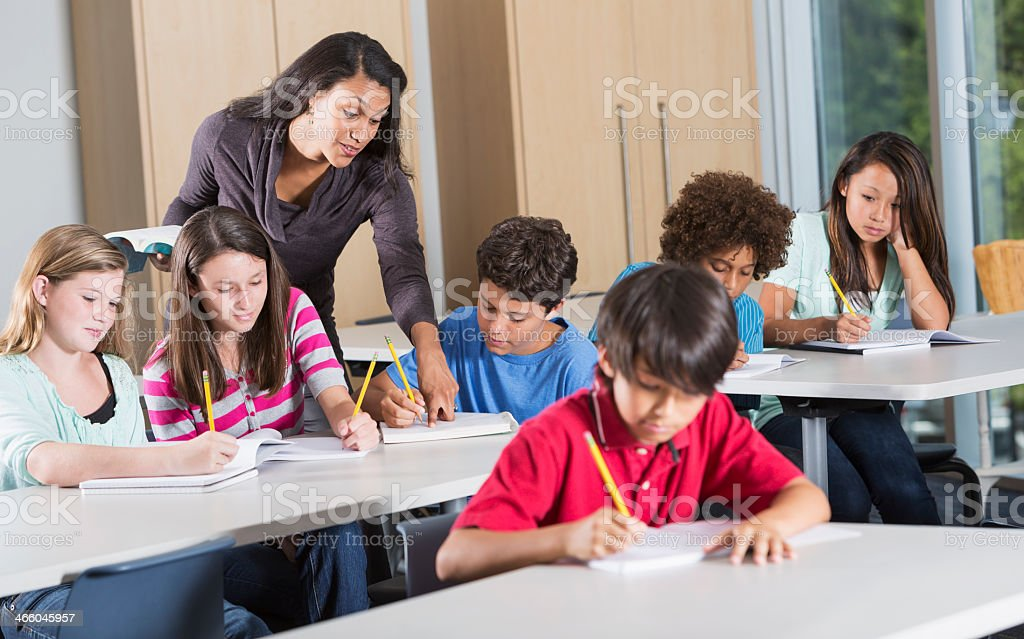 Teacher and students in classroom stock photo