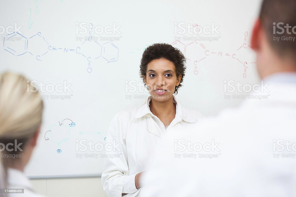 Teacher and students on chemistry class royalty-free stock photo