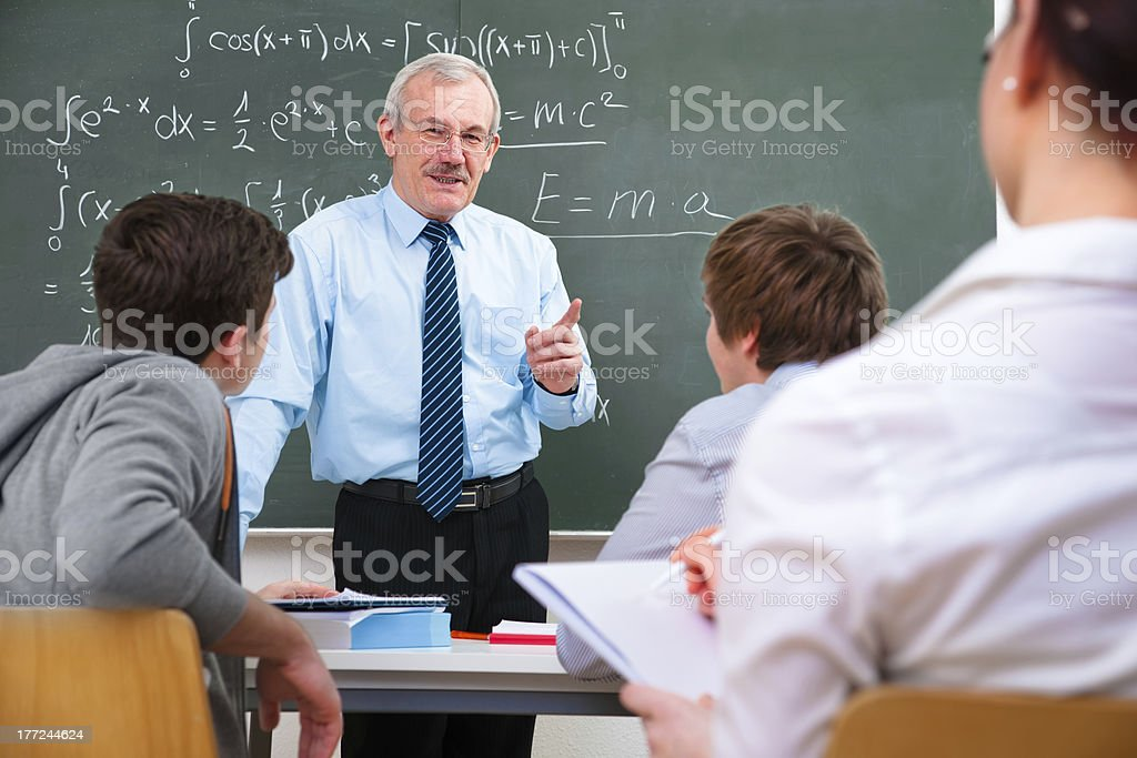 teacher and the  high school students stock photo