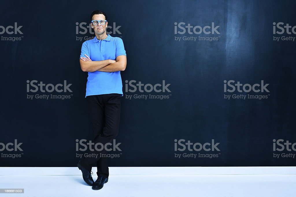 Teacher by blackboard with copy space royalty-free stock photo