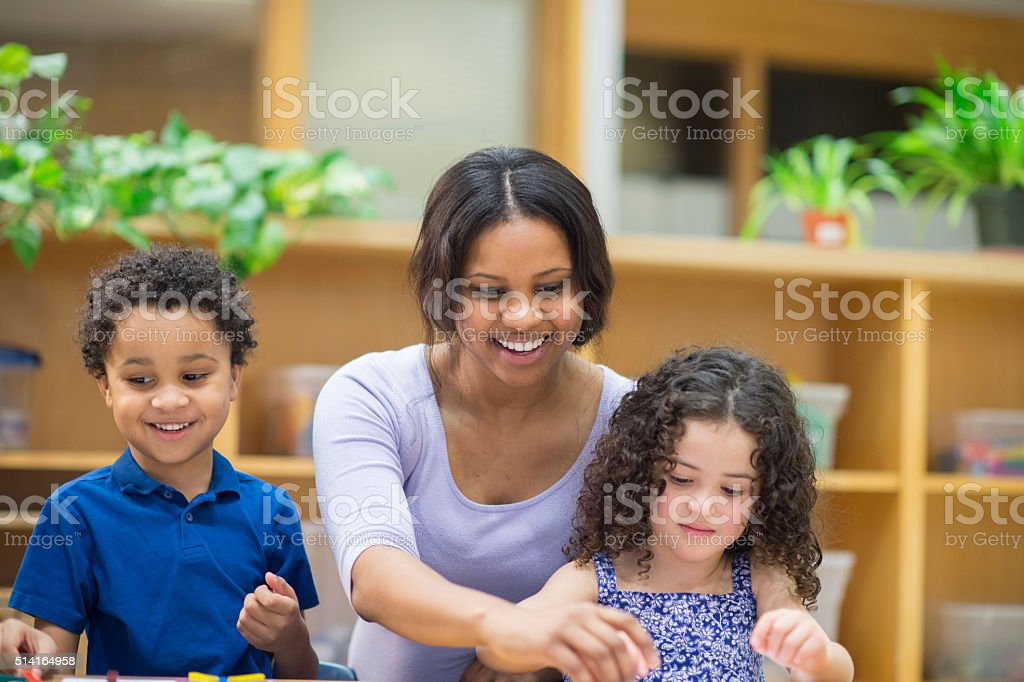 Teacher Doing Arts and Crafts with Students stock photo