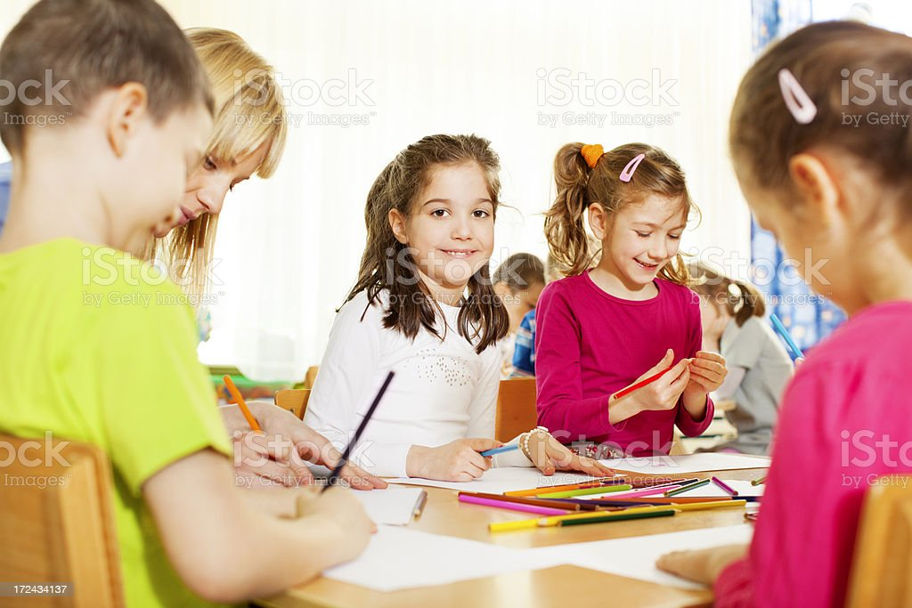 Teacher drawing with children. royalty-free stock photo