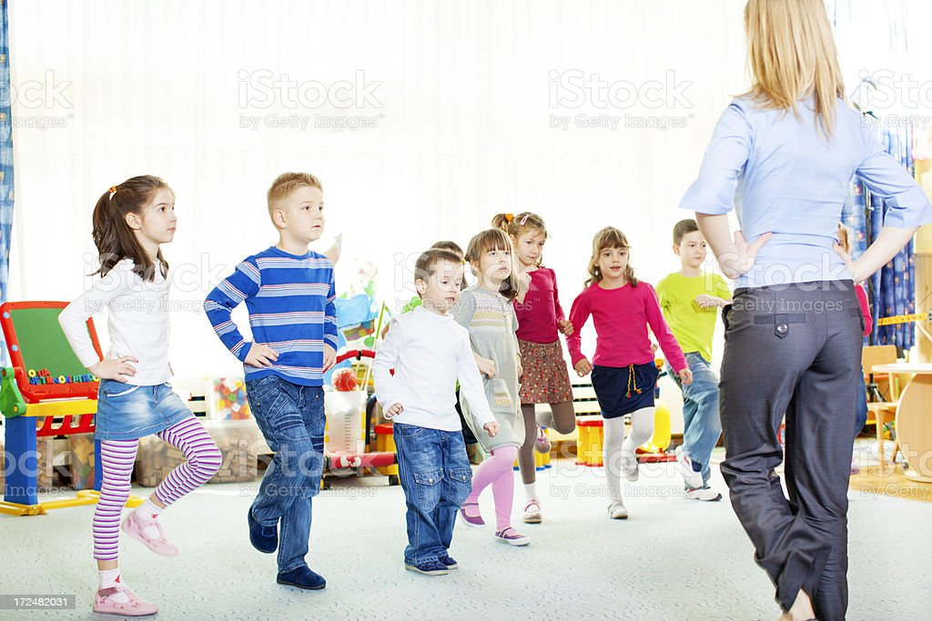 Teacher Exercise with Children. royalty-free stock photo