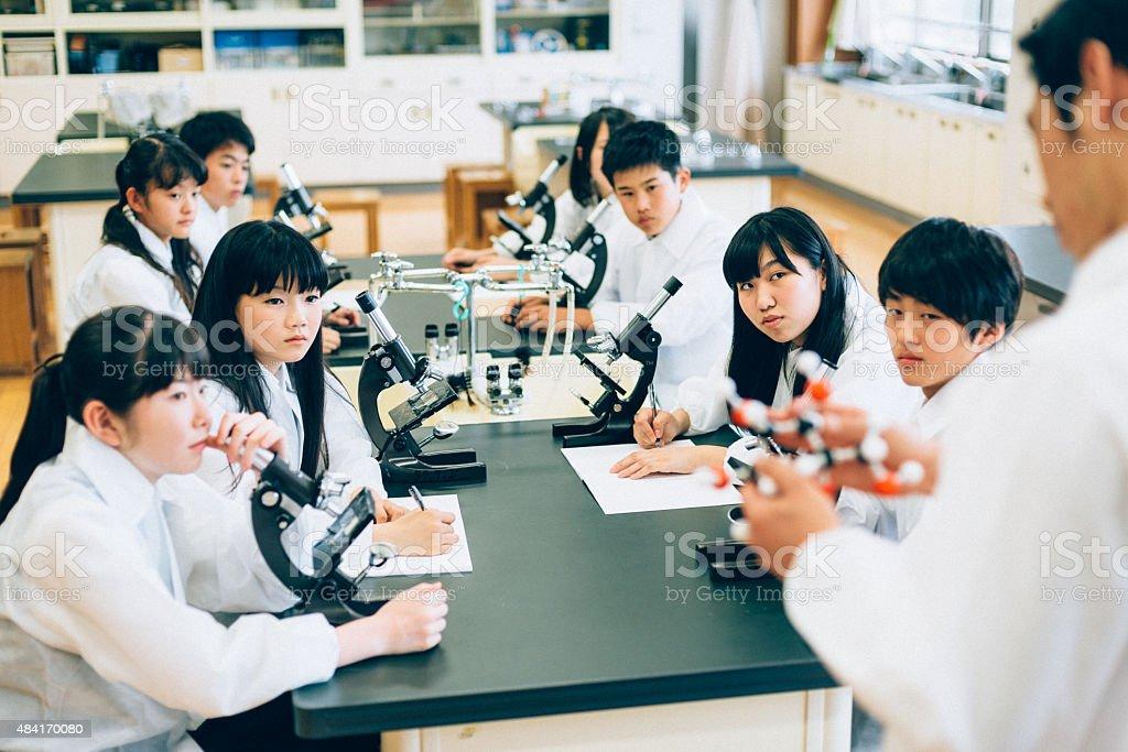 Teacher explaining molecules in Highschool Science Lab Class stock photo