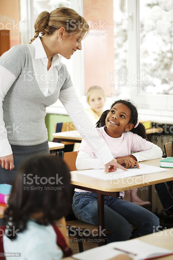 Teacher explains children in the classroom royalty-free stock photo
