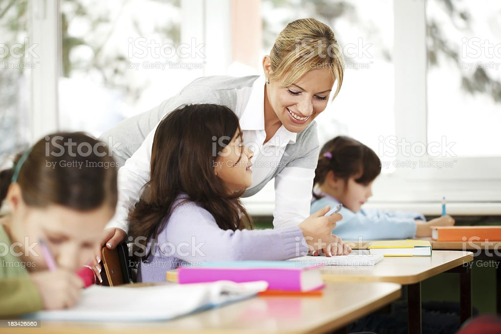 Teacher explains in the classroom. Children are listening. royalty-free stock photo