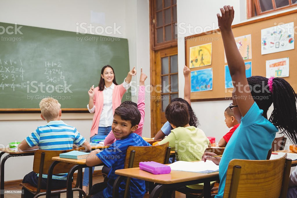 Teacher gettting an answer from a student stock photo