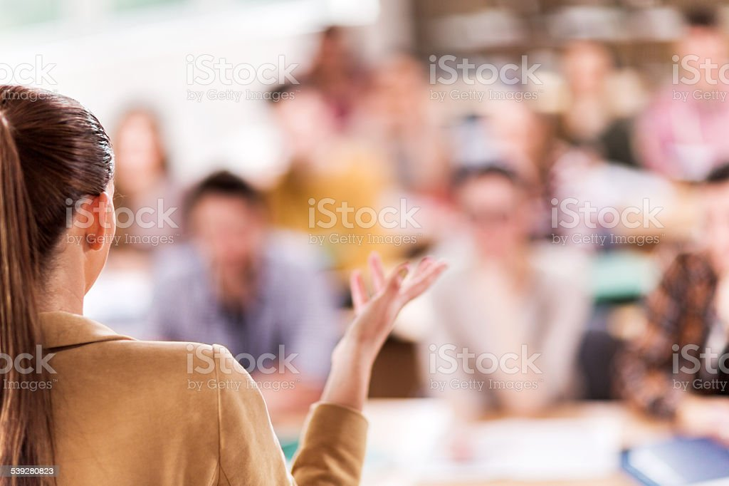 Teacher giving a lecture. stock photo