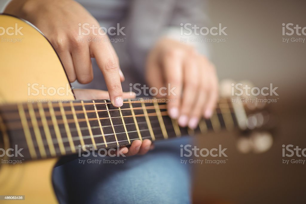 Teacher giving guitar lessons to pupil stock photo