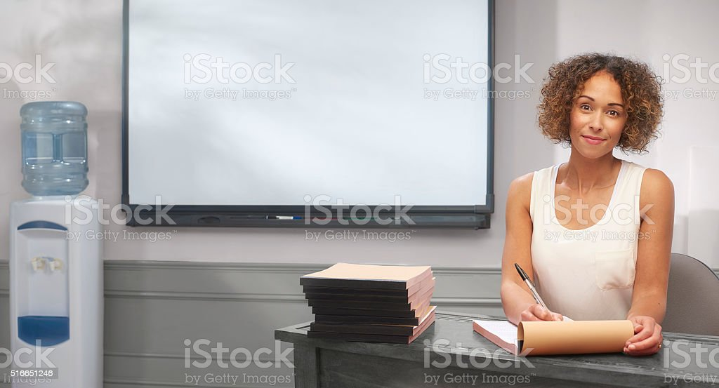 teacher grading work stock photo