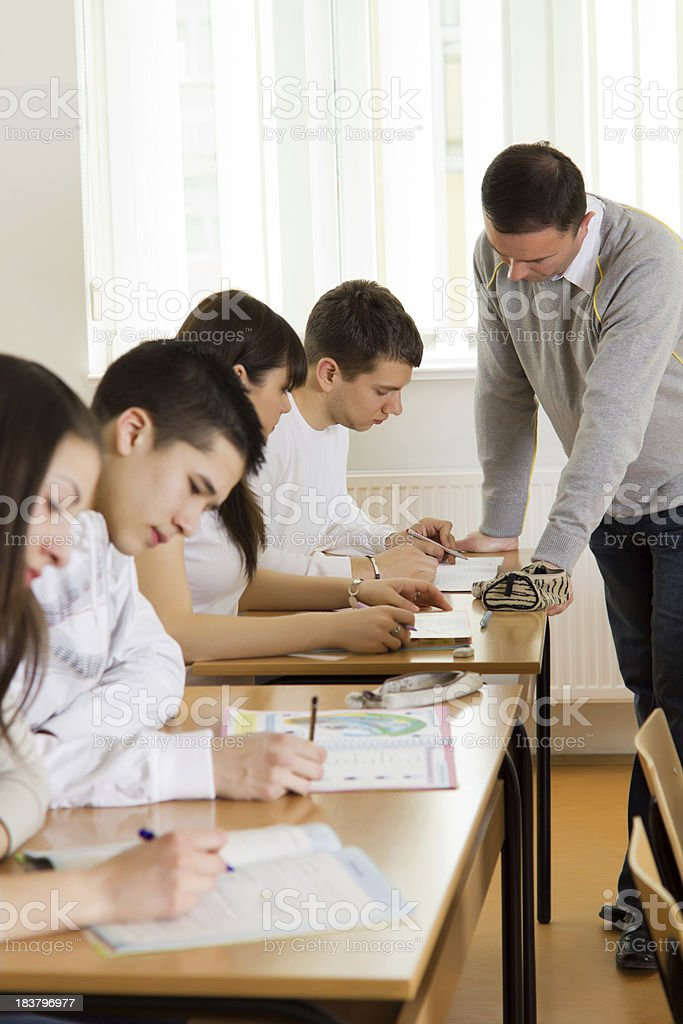 Teacher helping a high-school student with task. royalty-free stock photo