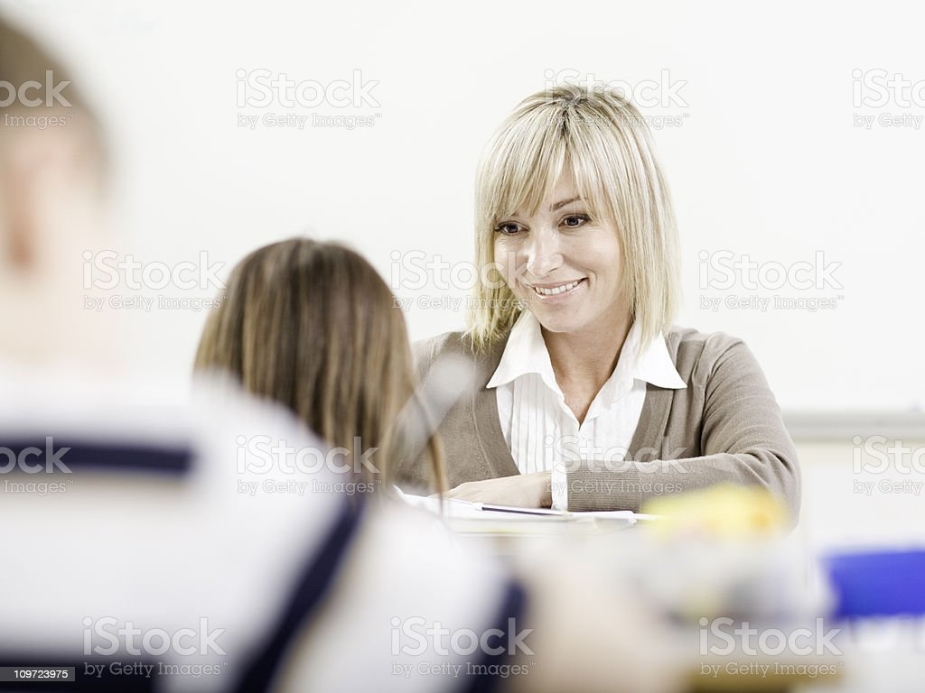 Teacher Helping a Student royalty-free stock photo