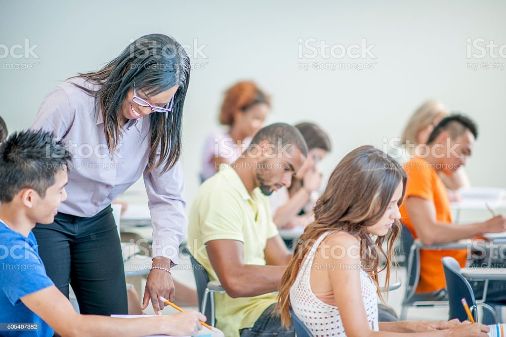 Teacher Helping a Student with a Question stock photo