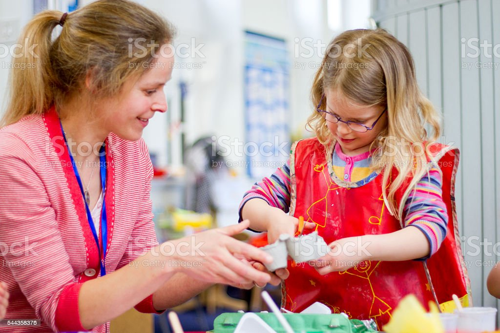 Teacher Helping in Arts and Crafts stock photo