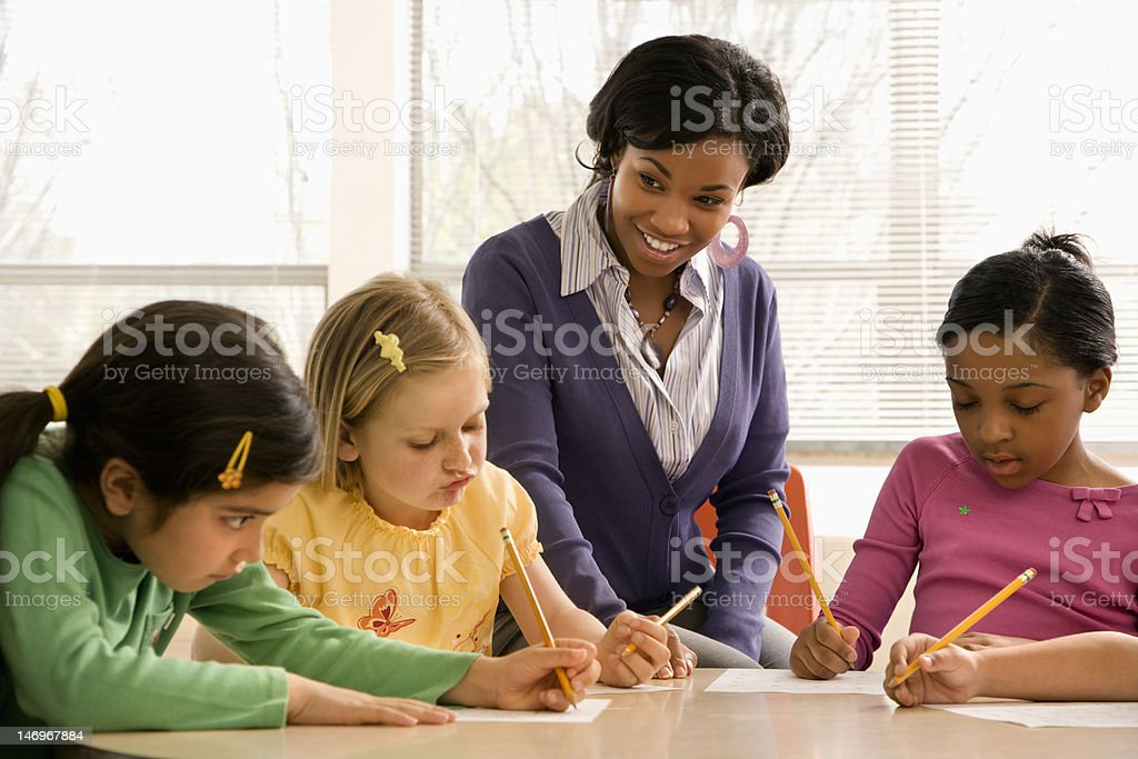 Teacher Helping Students stock photo