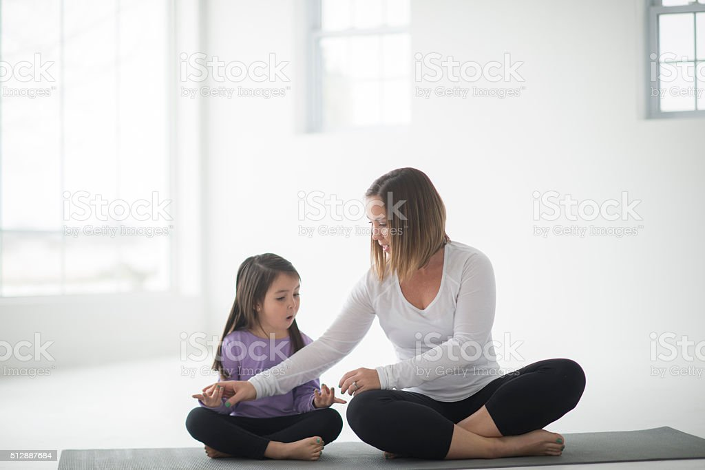 Teacher Her Daughter How to Meditate stock photo