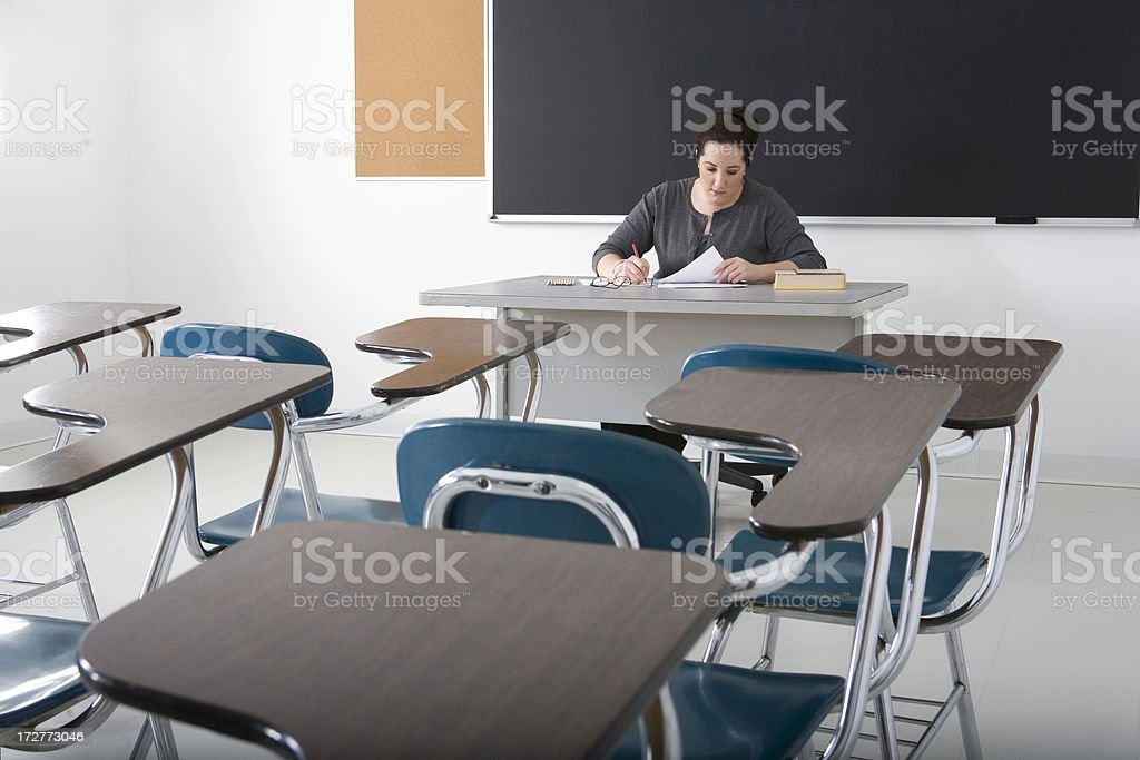 teacher in a classroom royalty-free stock photo