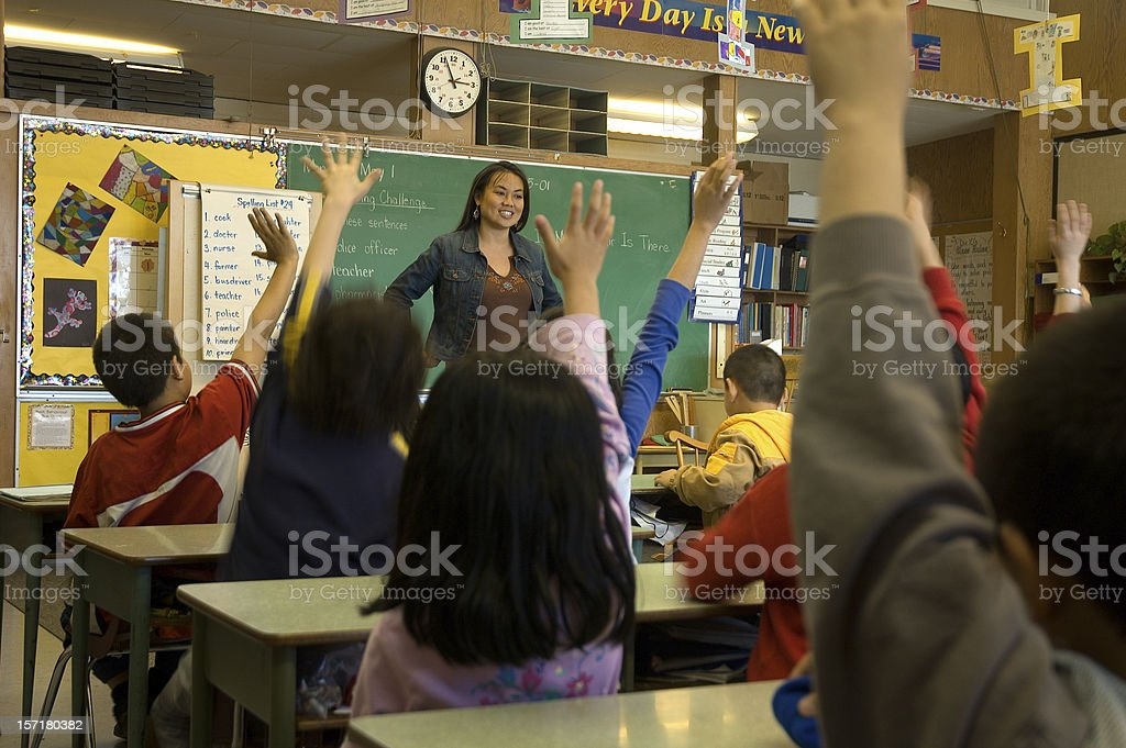 Teacher In Classroom royalty-free stock photo