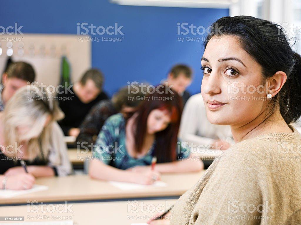Teacher in classroom stock photo