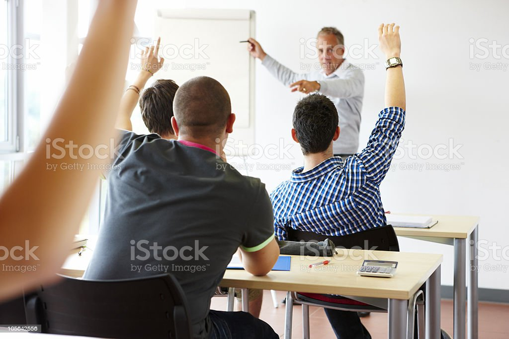 teacher in classroom with eager students royalty-free stock photo