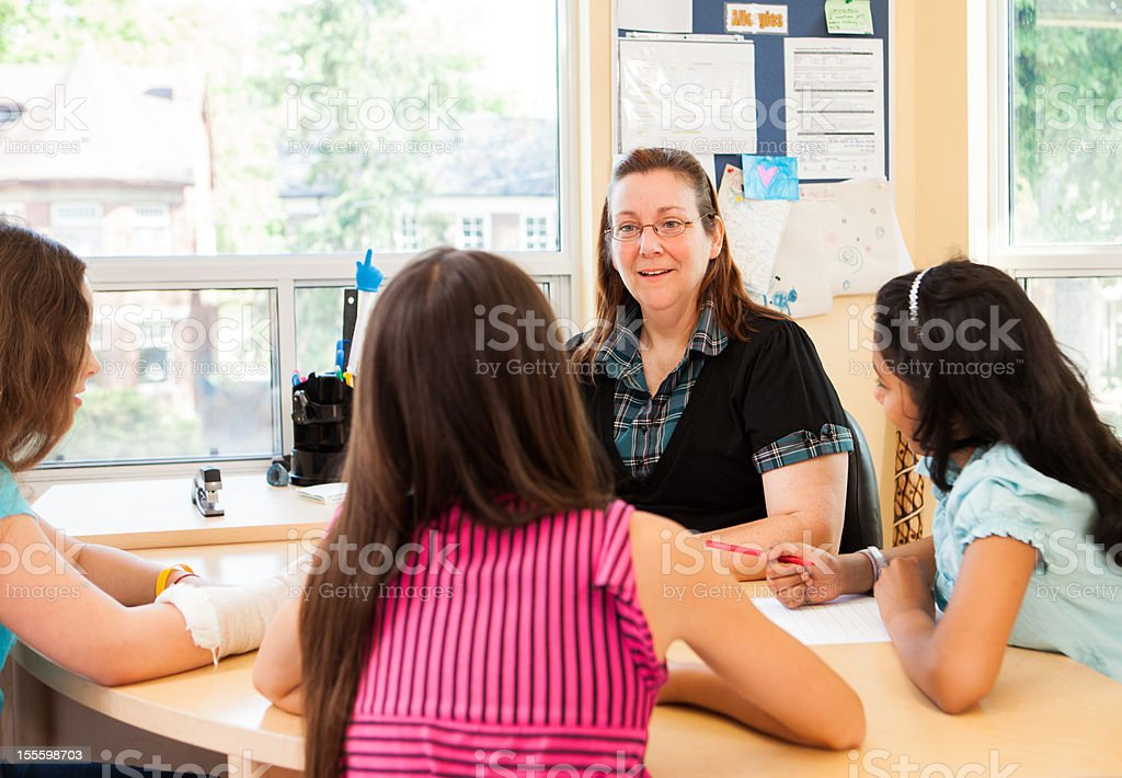 Teacher interacting with students royalty-free stock photo