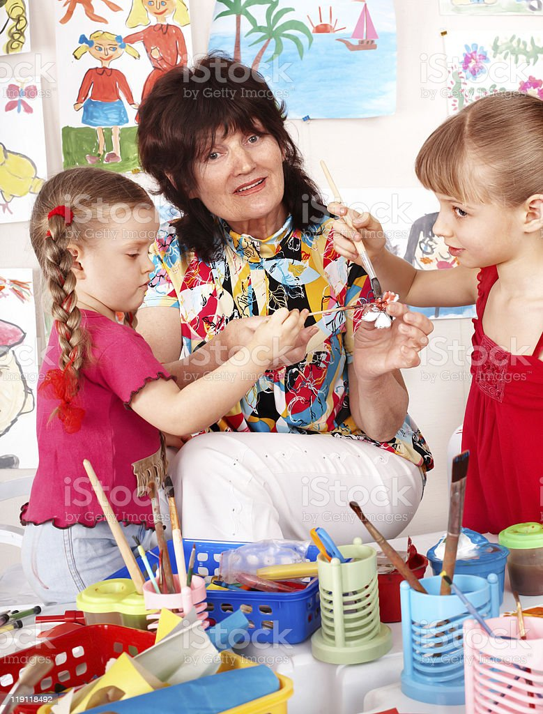 teacher learn children painting. stock photo