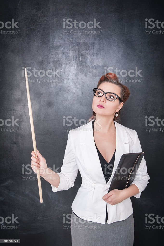 Teacher looking on something up stock photo