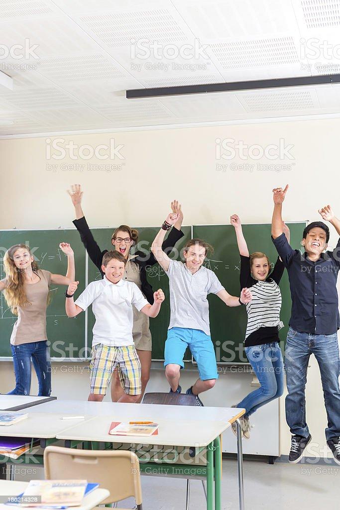 Teacher motivating students in school class stock photo