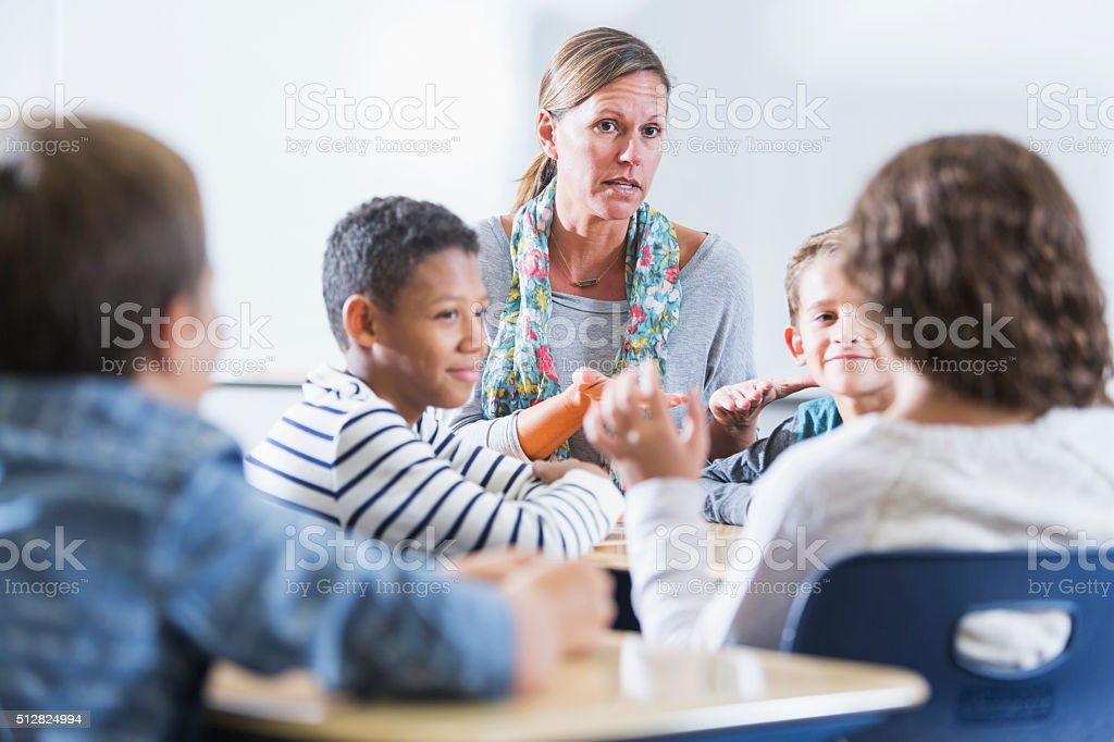 Teacher, multi-ethnic elementary school children, class stock photo
