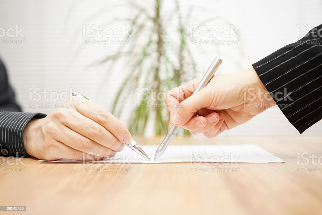teacher or instructor shows right answer on exam stock photo
