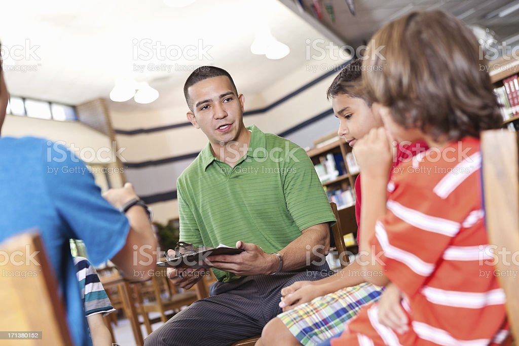 Teacher or mentor having discussion with group of students royalty-free stock photo